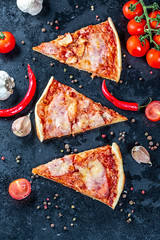 Flat lay composition slices of pizza with bacon, cheese and tomato sauce