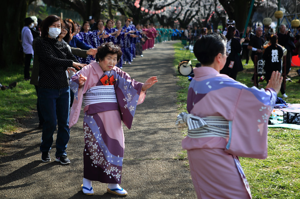 Japanese Women Celebrating The Return Of The Cherry Blossom