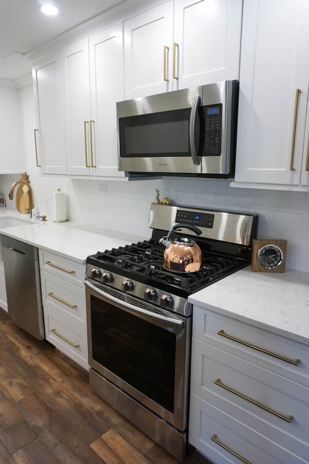 White Kitchen Cabinets Gold Hardware Pull Handles Stainless Steel Appliances