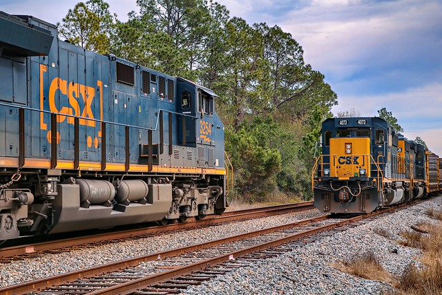 Loaded coal heads east as M744 waits in the Olustee Siding.