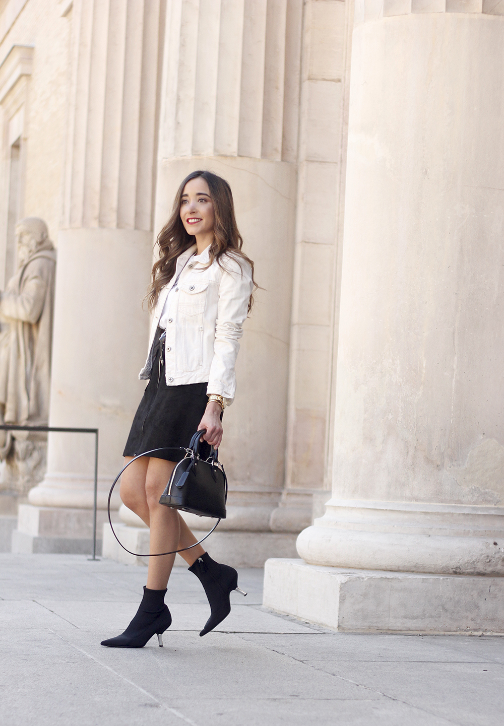 suede black skirt uterqüe ankle boots denim jacket louis vuitton bag street style outfit 20192
