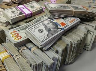 Piles of movie prop money