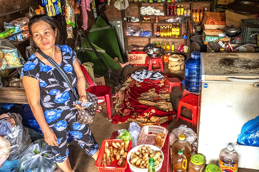 Vietnamese shop owner in a Rade village 2--Ea Kly