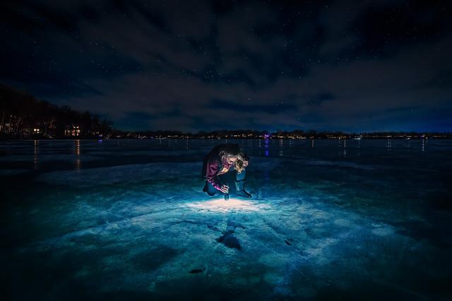 minnesota frozen lake ice flashlight