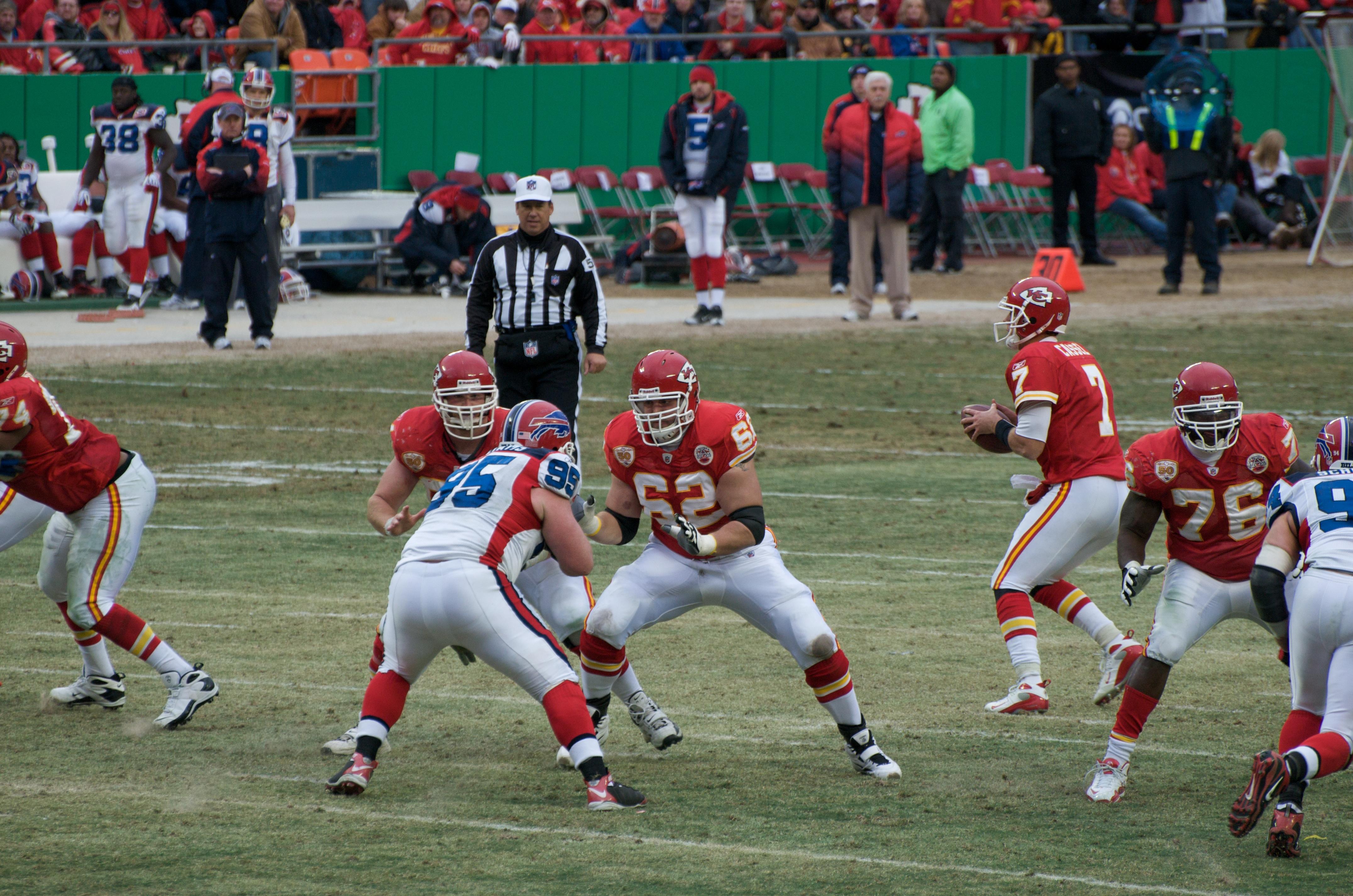 Andy Alleman (#62), Branden Albert (#76), and Rudy Niswanger of the Kansas City Chiefs blocks for Matt Cassel (#7) in a game against the Buffalo Bills at Arrowhead Stadium on December 13, 2009