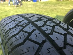 Closeup of Car Tire Pattern on Grass