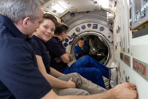 Waiting inside the Rassvet module to greet their new Expedition 59 crewmates