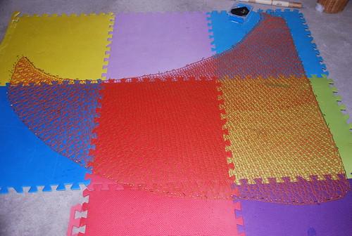 Blocking finished handspun Lacymmetry BFL/Silk madder dyed shawl by irieknit