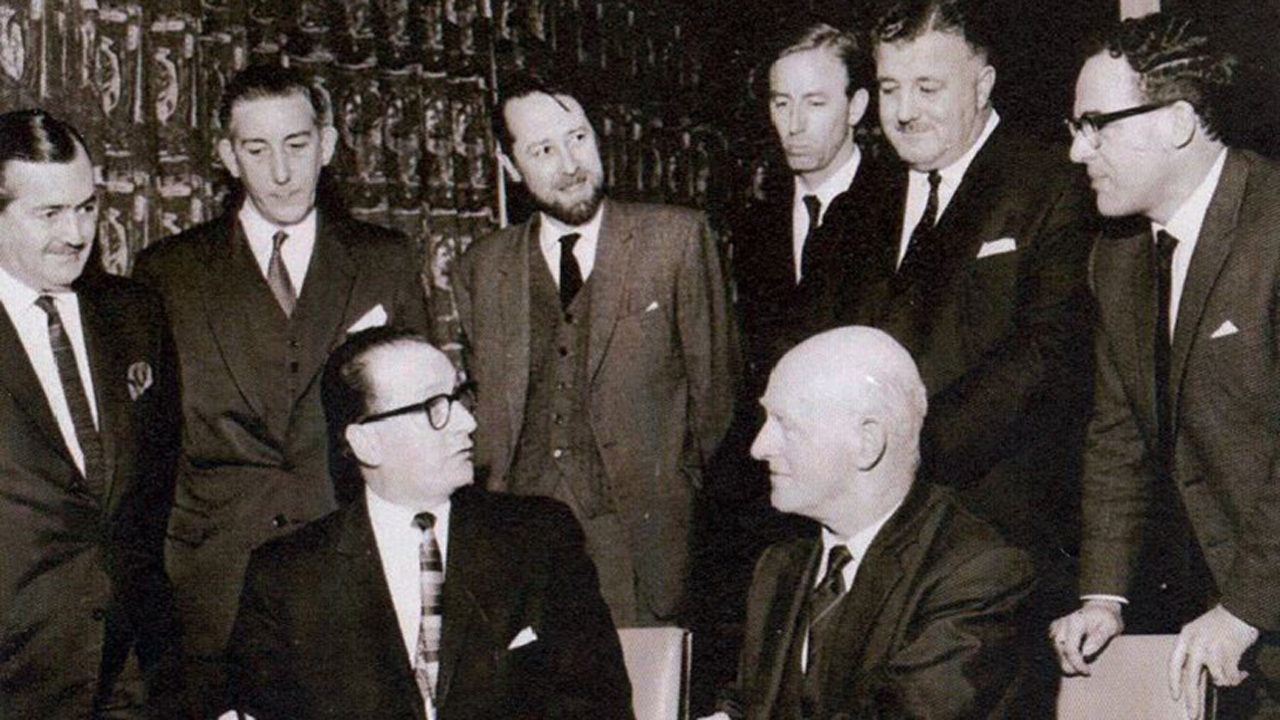 Dr James Nisbet at the signing of the contract for the first building on campus, 1984