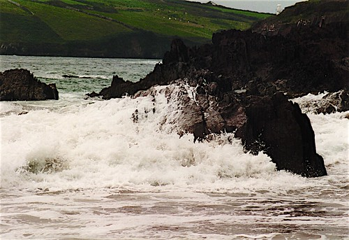 Waves on rocky cliff
