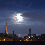 Moon behind the clouds over Preston