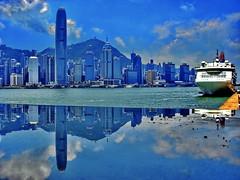 Hong Kong, reflecting skyline