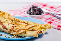 Close-up of pancakes with walnuts and plum jam