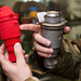 Senior Airman Nathanael Banden, 4th Civil Engineer Squadron explosive ordnance disposal technician, compares a M904 Bomb Nose Fuze to its 3-D printed counterpart, Dec. 14, 2016, at Seymour Johnson Air Force Base, North Carolina. With the ability to produce training aids using inexpensive plastic materials, EOD technicians can cut, shear, puncture or completely obliterate a training munition to fully complete an exercise without financial repercussions. (U.S. Air Force photo by Airman Shawna L. Keyes)