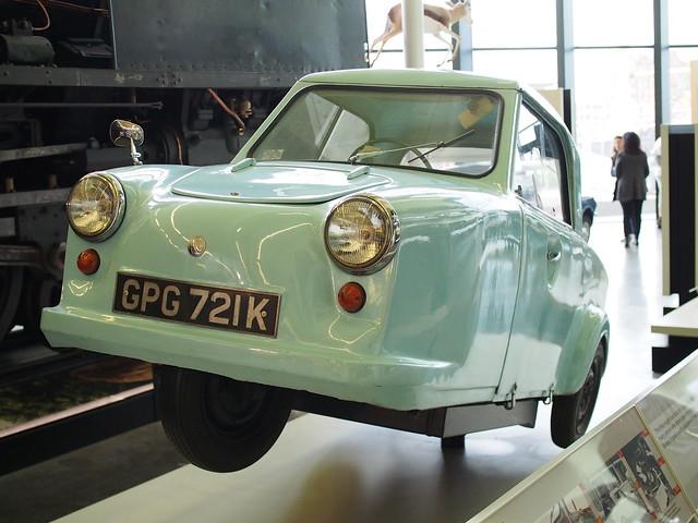 very pale acqua blue three wheeled vintage car