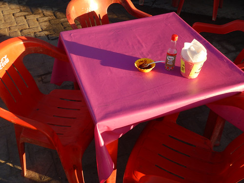 Red chairs & a pink table at a Fun Fair in Bucerias, Mexico