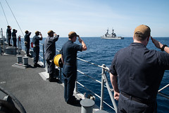 Sailors aboard USS Chief (MCM 14) render honors to BRP Ramon Alcaraz (FF 16) after conducting drills together. (U.S. Navy/MC2 Jordan Crouch)