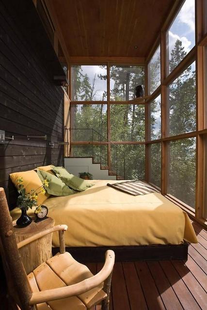Wood bedroom in a retreat in the wilderness, Bigfork, Flathead...