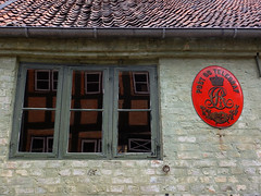 A Post Office with a red Telegraf sign at the recreated village of Den Gamle By in Aarhus, Denmark