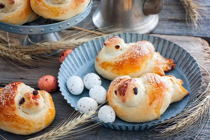 "Buns ""larks"", traditional spring pastries, copy space, horizontal"