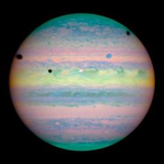 Three Moons Cast Shadows on Jupiter