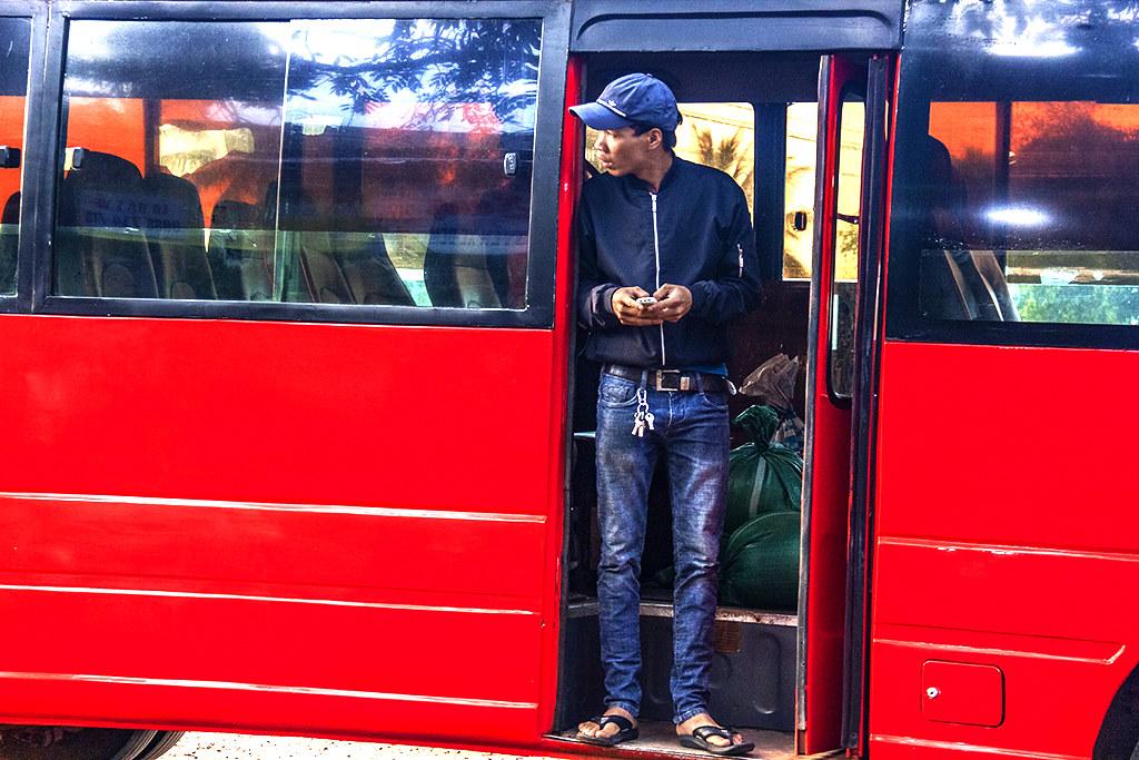 Man standing in bus doorway on 1-20-19--Ea Kly