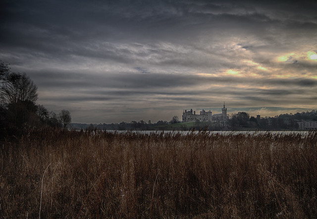 fine art moody impression looking across the loch and wind-blown reeds towards Linlithgow Palace, Linlithgow, West Lothian, Scotland