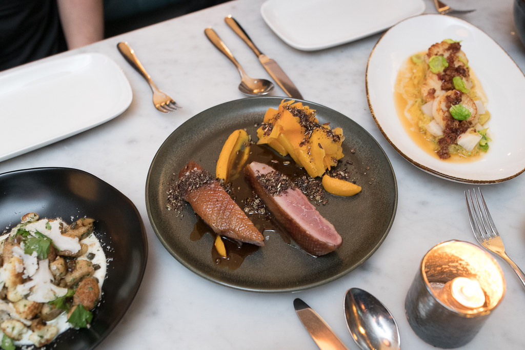 Aged Duck Breast with crispy skin paired with soft confit squash and tasty pumpkin seed crumble