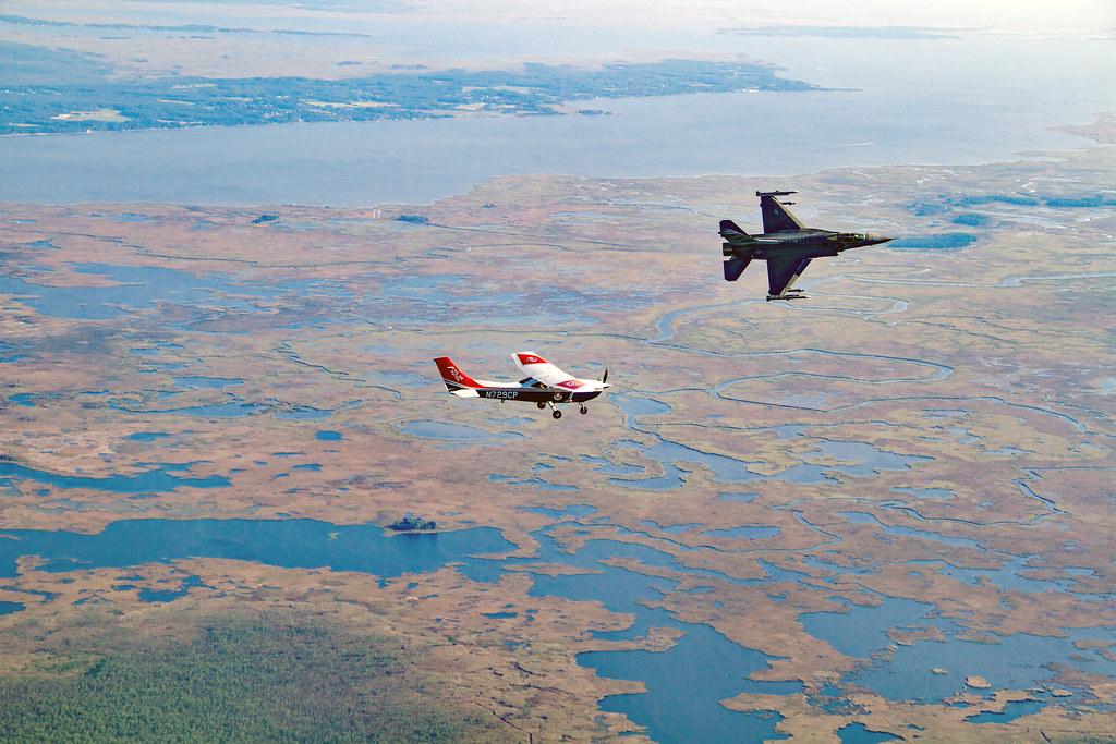 d14b692a401 A U.S. Air Force fighter jet soars past a CAP Cessna aircrew during an  intercept training ...