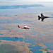 A U.S. Air Force fighter jet soars past a CAP Cessna aircrew during an intercept training exercise. CAP planes simulate trespassers in secured space so military pilots can practice dealing with such airspace violations. Photo // Civil Air Patrol