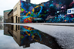 Mural in puddle reflection