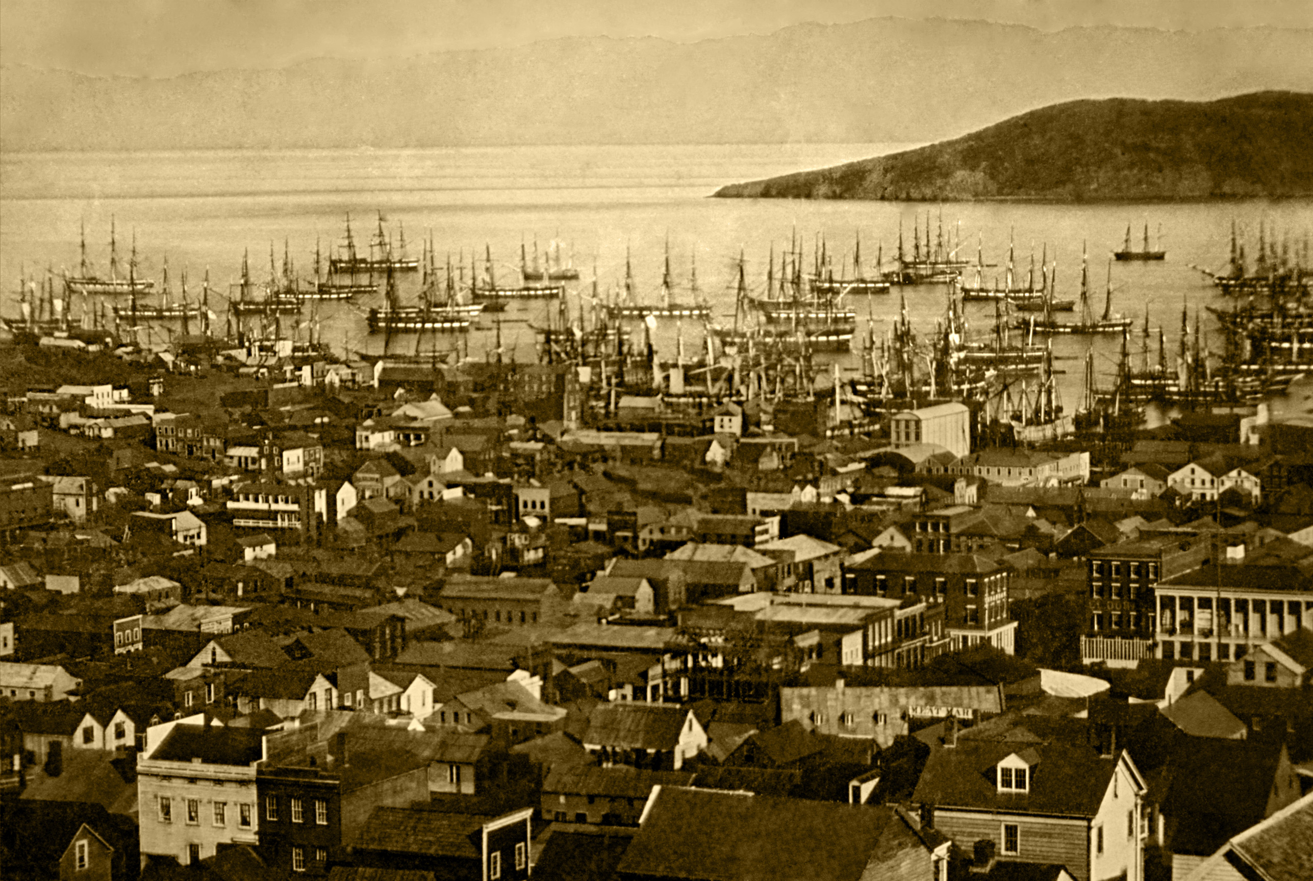 San Francisco harbor at Yerba Buena Cove in 1850 or 1851 — with Yerba Buena Island, and Berkeley Hills, in the background.