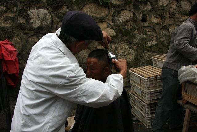 Hairdresser on the market in Machang, Guizhou