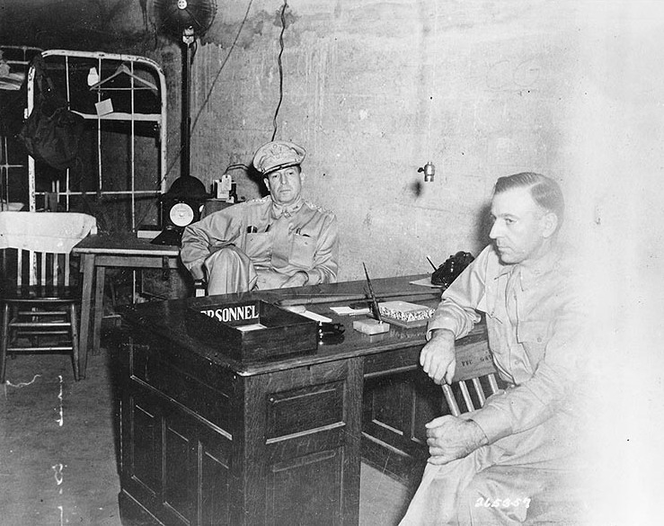 MacArthur (center) with his Chief of Staff, Major General Richard K. Sutherland, in the Headquarters tunnel on Corregidor, Philippines, on March 1, 1942. Photo taken by U.S. Army Signal Corps.