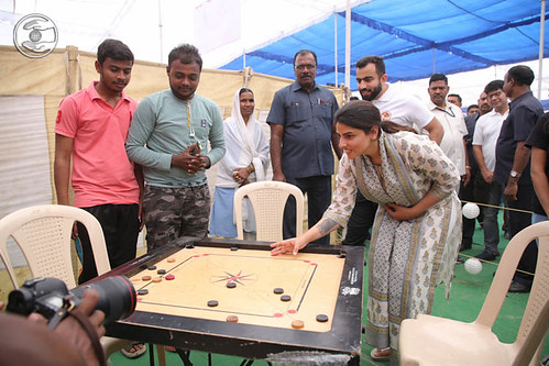 Satguru Mata Ji playing Carrom-board