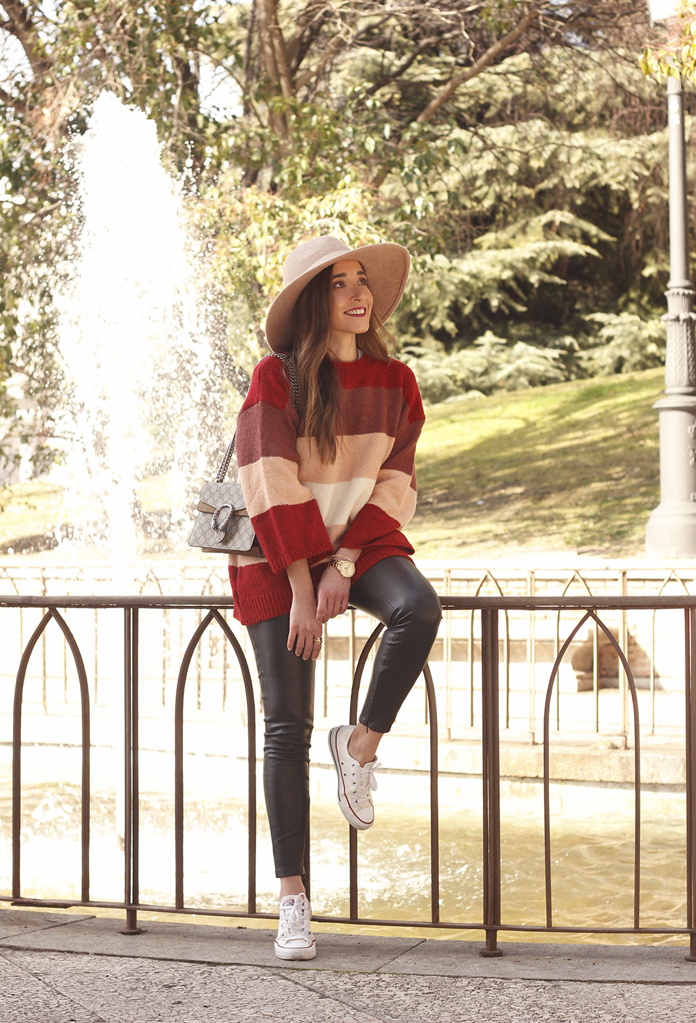 striped sweater leatherette pants converse gucci bag street style outfit 20191