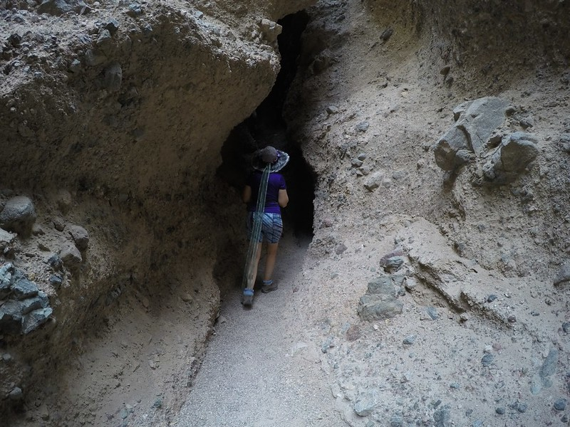 Vicki entering the darkest section of Slot Canyon Two in Sidewinder Canyon