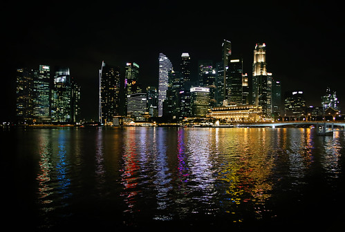 Singapore skyline at night and city reflections