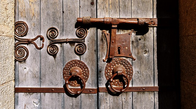 Medieval wrought iron work on the door of Sant Pere's Church, Albanyà, Catalonia, Spain
