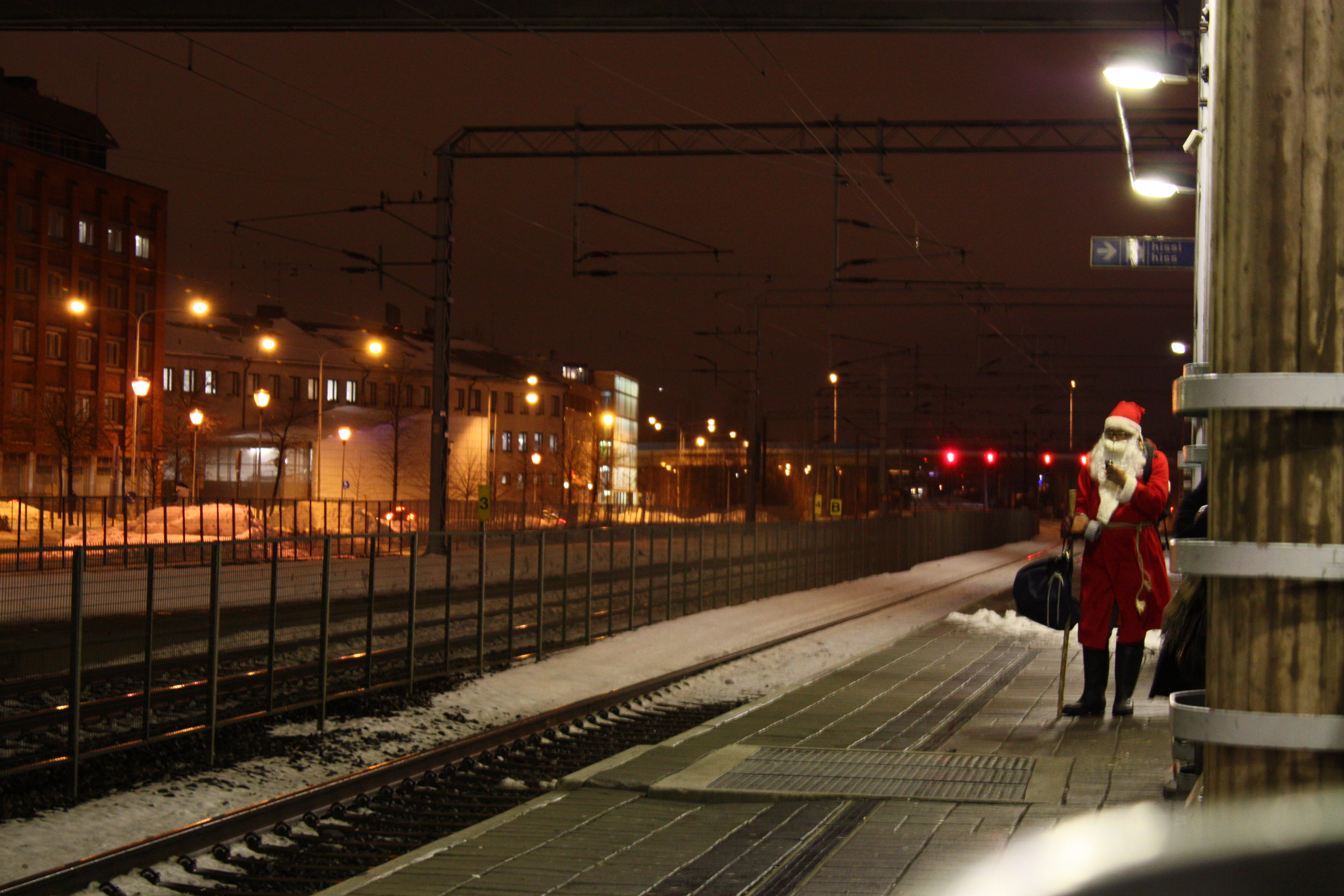 Santa Claus waiting for a train at the Malmi railway station in Helsinki, Finland. Photo taken on November 27, 2008.