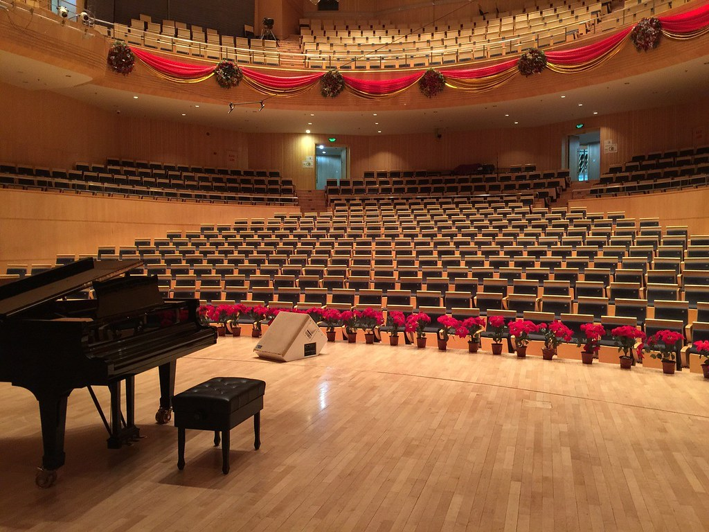 piano on stage in unoccupied concert hall
