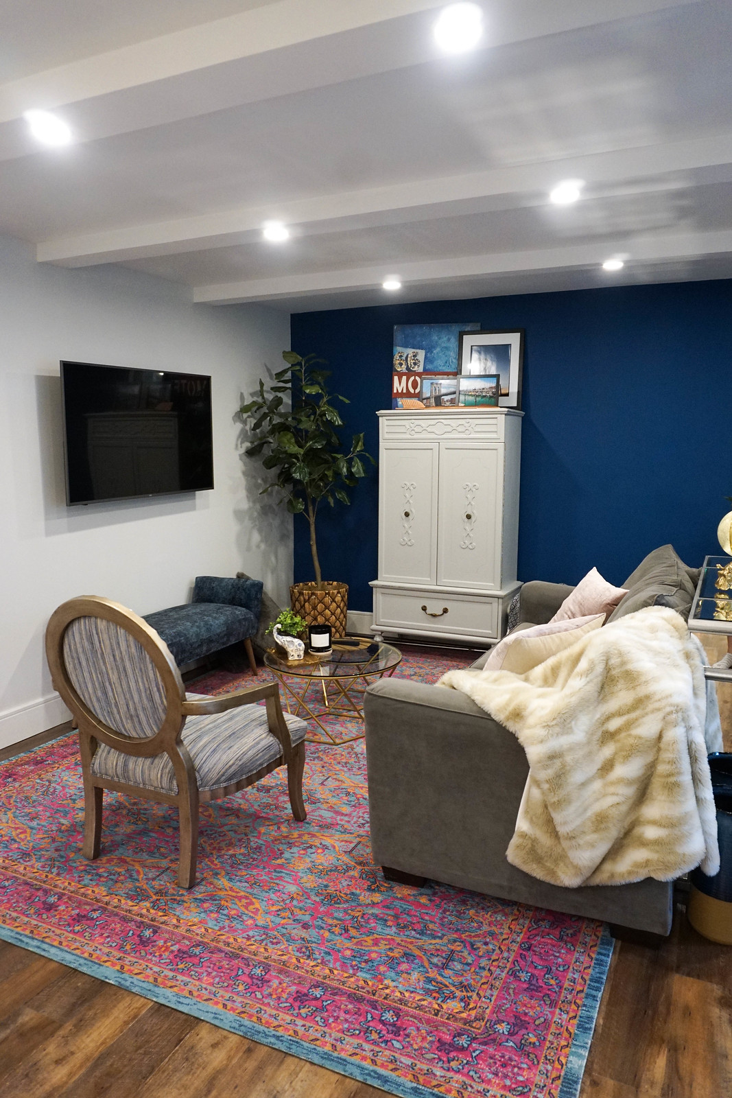 Eclectic Jewel Tone Living Room Pink Traditional Floral Area Rug Vintage Armoire Benjamin Moore Slate Teal Paint
