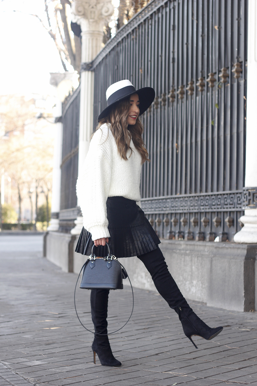 black pleated skirt  white sweater louis vuitton bag street style inspiration 20191