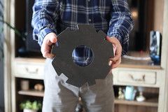 Bernard, retiree, former worker at the nuclear power station in Saint Laurent Nouan show a piece of graphite material, which was used to protect nuclear combustive inside the first generation reactors