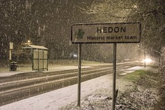 Hedon sign snowing