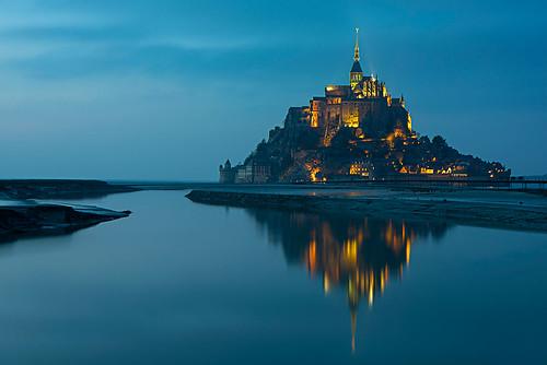 Mont Saint Michel at sunset , Normandy France