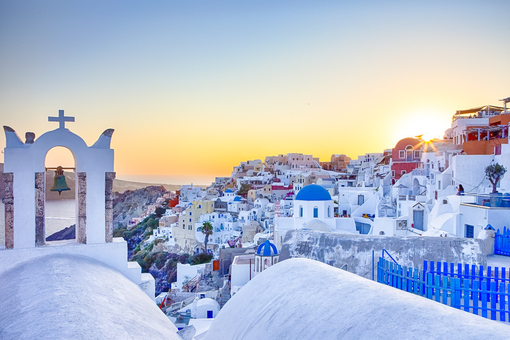 Romantic Destination. Amazing and Breathtaking View of Picturesque Cityscape of Oia Village on Santorini Island with Caldera Mountains On Background Before Dusk.