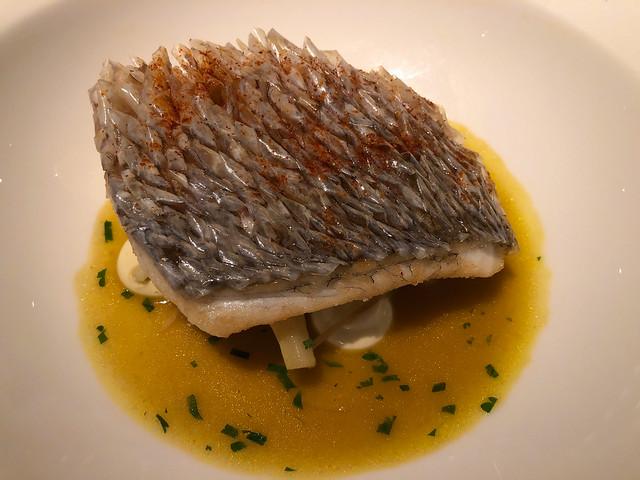 Crispy scale red sea bream, artichoke barigoule, squid piment d'espelette, claim aioli