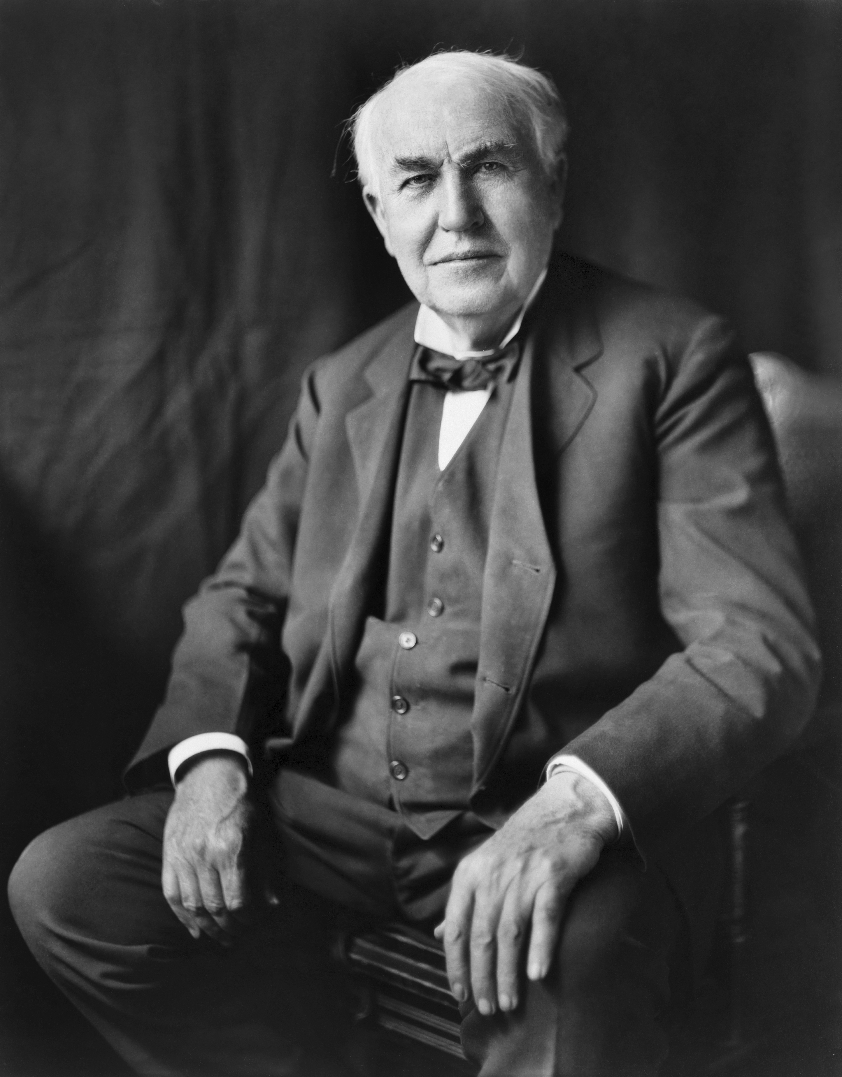 Thomas Alva Edison, three-quarter length portrait, seated, facing front, circa 1922. Photo taken by Louis Bachrach, Bachrach Studios, restored by Michel Vuijlsteke (dust and scratches removed, global and local histogram changes; some local sharpening). This image is available from the United States Library of Congress's Prints and Photographs division under the digital ID cph.3c05139.