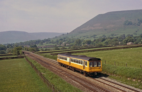 In 'Merseyrail' livery 142043 passes through Edale with the 10.43 Manchester Piccadilly-Sheffield service on 31May2003.